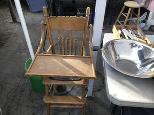 Vintage child's high chair in good shape with a leather seat for Sale in Modesto, CA