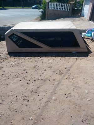 Camper shell fits toyota tundra and chevy, ford trucks maybe others nice shell for Sale in San Diego, CA