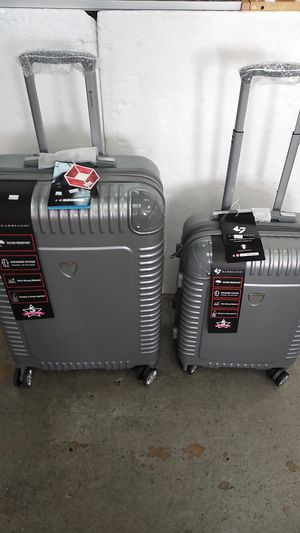 GABBIANO 2 PIECE SILVER LUGGAGE SET $85.00 BRAND NEW 8 WHEELS SPINNERS LIGHT WEIGHT EXPANDER SYSTEM WATER RESISTANT BUILT-IN TSA LOCK. for Sale in HALNDLE BCH, FL