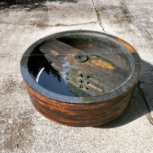 Antique wood mill wheel industrial coffee table glass top for Sale in Tigard, OR