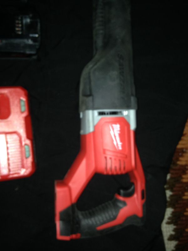 Milwaukee saws all 2 batteries and one charger