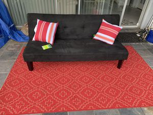 65 inch futon in very good condition and very comfortable the rug and the pillows do not come with it thank you for Sale in Palm Harbor, FL