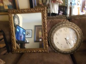 "Wall decor ornate framed mirror and large 24"" Howard Miller clock $20 for both for Sale in Henderson, NV"