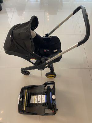 Doona Infant Car Seat & Stroller Black with car base for Sale in Miami, FL