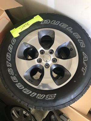 Set of four Jeep wheels and tires with spare for Sale in Pasadena, MD