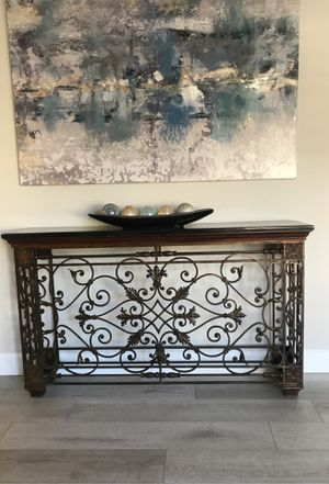 Sofa table 35 high by 60 inch long . Top black marble and iron for Sale in Rancho Santa Margarita, CA