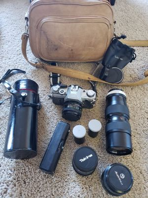 Canon AE1 film camera with several lenses and power winder for Sale in Castle Rock, CO