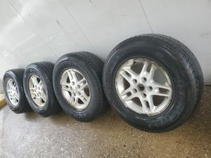 4 16 in 5x127 wheels rims and tires. Jeep for Sale in Martinsburg, WV