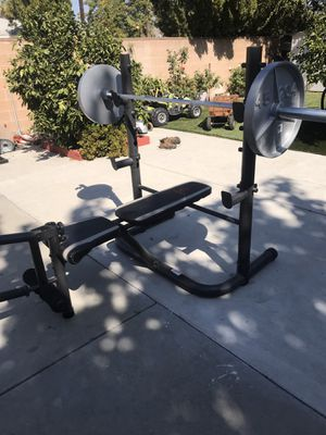 bench press/ squat rack with olympic bar and weights for Sale in Los Angeles, CA