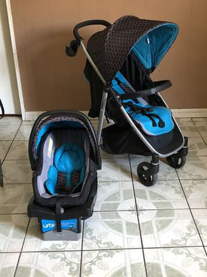 PRACTICALLY NEW URBINI OMNI PLUS TRAVEL SYSTEM STROLLER CAR SEAT AND BASE for Sale in Riverside, CA