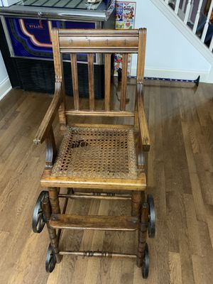 Antique high chair / wheelchair for Sale in Mauldin, SC