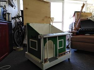 Small Dog House, with wheels, Handles and Top can be open for Sale in Kissimmee, FL