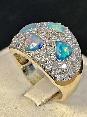 Diamond and fire opal gold lady's ring for Sale in Riverview, MI