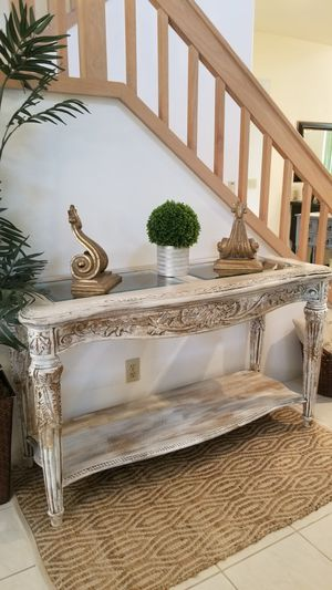 ORNATE CARVED WOOD/ACCENT TABLE W GLASS TOP AND BOTTOM STORAGE SHELF(MATCHING COFFEE TABLE AND END TABLES SET ARE AVAILABLE)/ENTRYWAY/CONSOLE for Sale in Chino Hills, CA