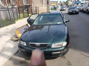 2000 Mazda millenia parts / tires& rims (whole car) for Sale in Queens, NY