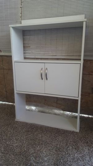 Bathroom or kitchen cabinet two doors. white in great shape messuments 33 tall 23wide 7.5 deep for Sale in Moreno Valley, CA