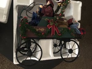 Traditions hand crafted & hand painted family in holiday carriage for Sale in Fresno, CA