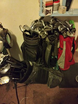 About 50 golf clubs/ 4 bags/about 50 golf balls for Sale in Obetz, OH