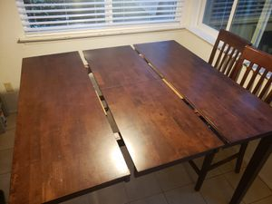 Expanding Rectangular wood table with chairs for Sale in Austin, TX