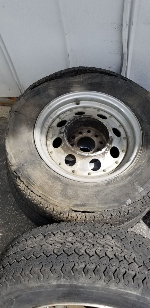 Universal trailer tires 3 tires are good one as a blow out the worst rim is the 1 that's all rusted around the edge 100 bucks or best offer