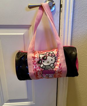 GIRLS PINK WITH SPARKLING BLACK SEQUENCE HELLO KITTY SMALL DUFFLE BAG for Sale in Colorado Springs, CO