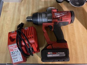 """Milwaukee 1"""" drive impact wrench 1800 Nut breaking torque with 6.0 batt and charger 600 is firm for Sale in Lakeland, FL"""