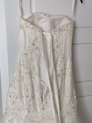 Tailor made size 6 wedding dress! Never worn, cream, sweetheart neckline with beading throughout. Corset back. for Sale in Phoenix, AZ