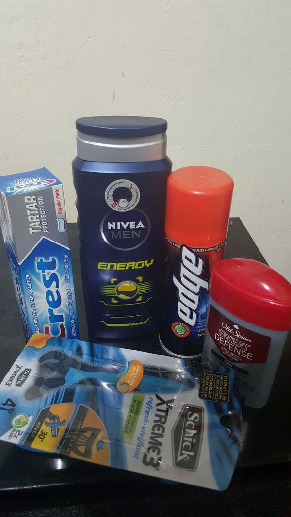 Schick xtreme3, nivea men 3-in-1 body wash, edge shaving cream, n old Spice deodorant, crest toothpaste