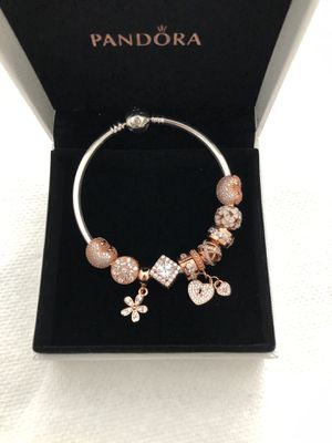 Pandora bracelet with 10 rose gold charms for Sale in Alexandria, VA