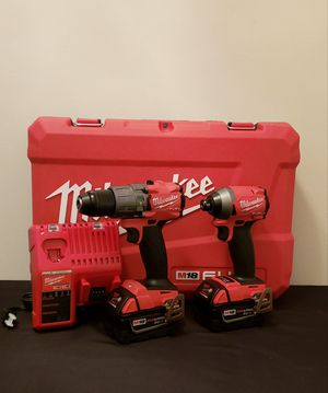 New Kit Milwaukee Impact and Hammer Drill Whit Batteries 5.0 Charger and Case FIRM PRICE for Sale in Woodbridge, VA