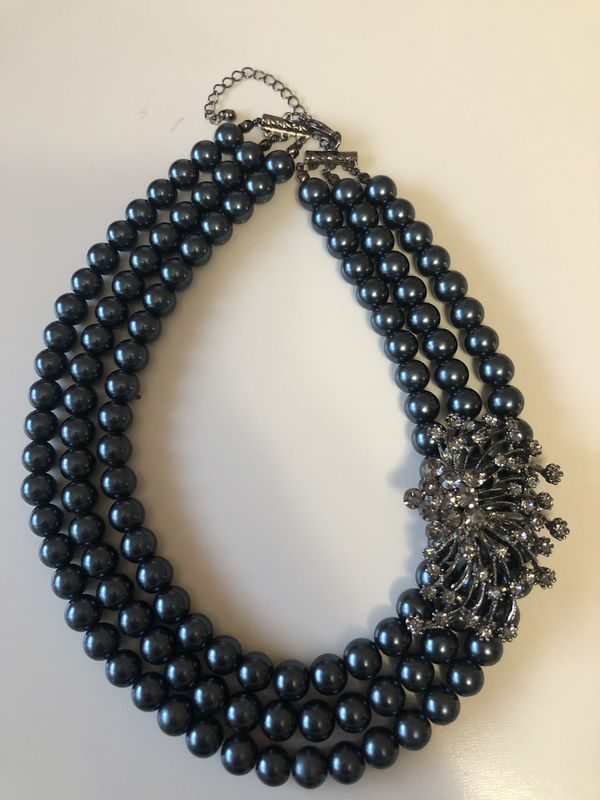 Gunmetal grey pearlesque triple strand necklace with rhinestone accent