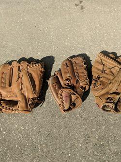 Three Baseball Gloves In Great Shape for Sale in Oviedo,  FL