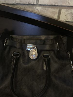 Authentic Michael Kors black/silver Michael Kors purse with lock and key for Sale in Auburndale, FL