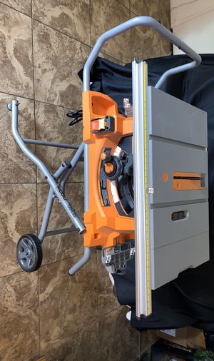 RIDGID 15 Amp Corded 10 inch Table Saw with Stand and wheels for Sale in Buena Park, CA