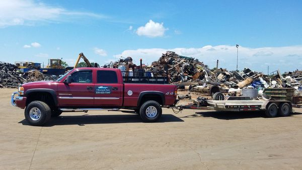 We pay CASH for junk cars, flooded, running or not. No title necessary. FREE towing, same day pickup.