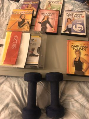 6 workout DVDs , two resistance bands and a set of 5 pound weights for Sale in Ontario, CA