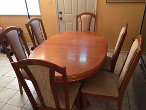Solid wood dining room with 2 built Leaf and 6 chairs for Sale in Manassas, VA
