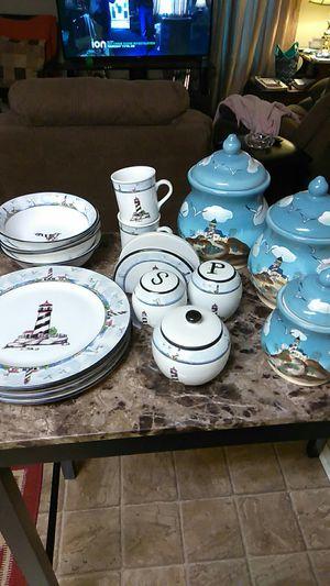 Lighthouse kitchen set.21 pc set include salt/pepper shakers,napkin holder and sugar bowl. $30 OBO for Sale in Greenville, SC