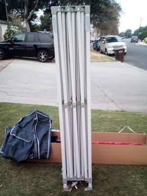 Carpa keymaya 10x15 con lona Roja nueva y bolsas para la arena ( la abrí nada más para la foto ) Keymaya canopy 10x15 with Red canopy new. for Sale in El Monte, CA