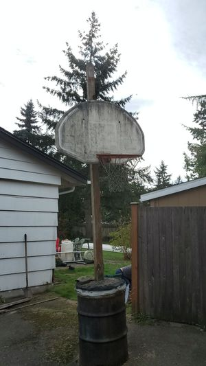 Basketball hoop in cement barrel for Sale in Mountlake Terrace, WA