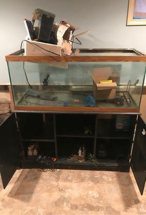 75 gallon fish tank with stand. Comes with pump and other accessories 250 or best offer for Sale in Middletown, PA