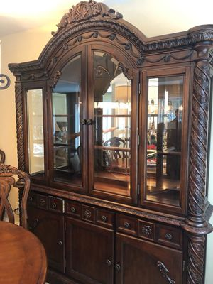 Beautiful hutch and table set from Ashley Furniture for Sale in Traverse City, MI