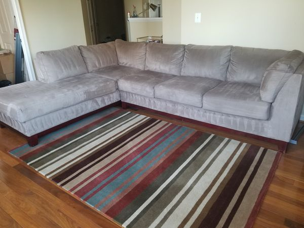 Living room set - sectional couch, rug, ottoman, bookcase, & TV stand