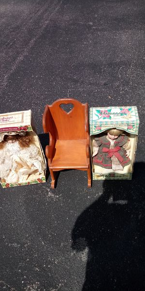 2 porcelain dolls in box with doll chair for Sale in Newport News, VA