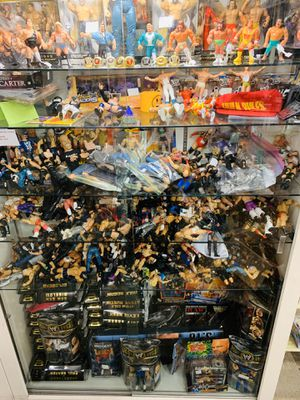 Wwe, records, toys, sports memorabilia items , cards Disney pins pops more for Sale in Phoenix, AZ