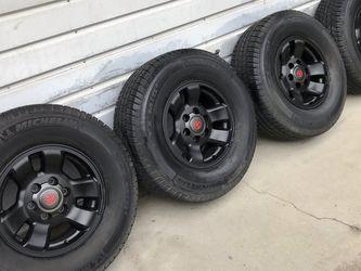 "4 Toyota Tacoma Trd Black 16"" OEM Rims 6 Lug 3 Michelin LXT @ 90tread 1 Bridgestone 265/70R16 balanced no sensors good Condition $275 in Ontario 9176 for Sale in Ontario,  CA"