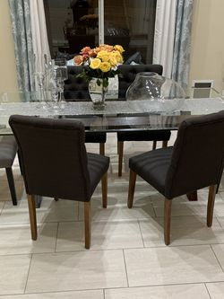 Six chair dining table modern glass top for Sale in Las Vegas,  NV