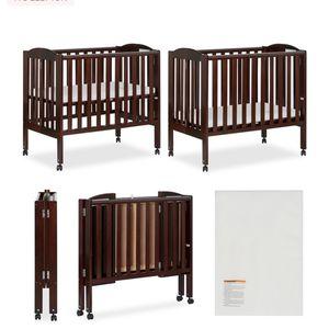 Mini fold up crib , mattress & mattress pad and minnie sheet set if wanted for Sale in Glen Burnie, MD