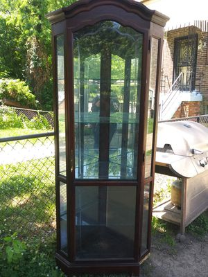 Corner curio cabinet with light and glass shelves 7' tall for Sale in Washington, DC