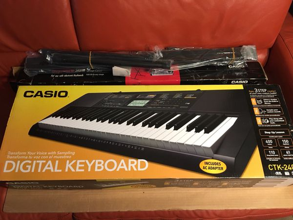 Like New Casio 61 Key keyboard with 2 stands
